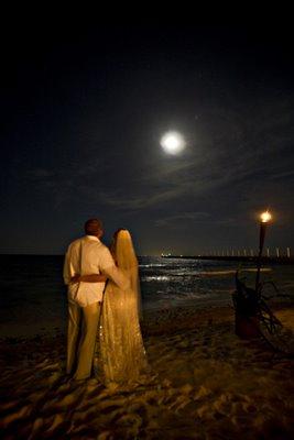 Beach couple under full moon