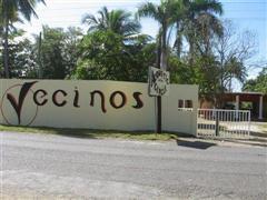 Vecinos wall sign