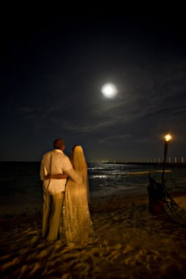 Beach couple under full moon