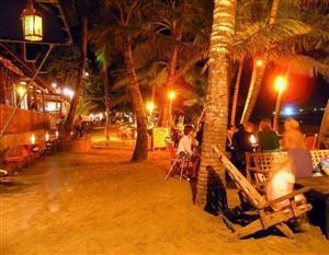 Cabarete night life - beach restaruants lit up